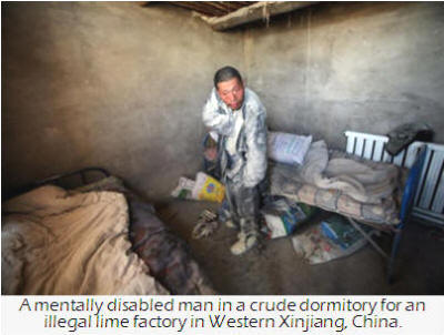 A mentally disabled man in a crude dormitory for an illegal lime factory in Western Xinjiang, China.